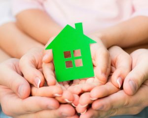 family-holding-a-green-house